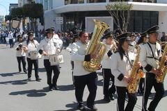 Brass band marching along the street royalty free stock photography