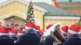 Brass band playing Christmas carols creating holiday spirit, street performance stock footage