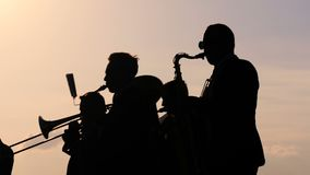 Brass band playing wind instruments stock video footage