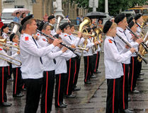 Brass band of pupils in a wet day Royalty Free Stock Images