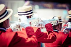 Brass Band in red uniform performing. In parade stock image