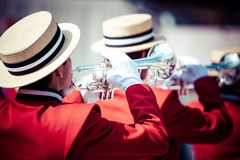 Brass Band in red uniform performing. In parade royalty free stock images