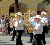 Brass band on the street parade Stock Photos