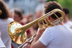 Trombone player on road royalty free stock image