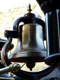 Brass Bell. Antique hand operated brass bell on vintage narrow gauge steam engine stock images