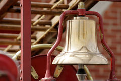 Brass Bell. On a fire truck- blurred ladder in background Royalty Free Stock Photos