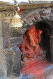A brass bell at Ganesha Hindu shrine in Kathmandu Stock Photography