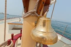 Brass bell on the private sail yacht. Stock Photography