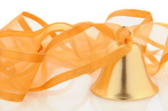 Brass bell with ribbon Stock Images