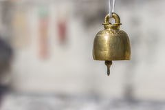 Brass bell. Small bell used for Buddhist ceremony on blur background royalty free stock image