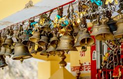 Brass bells in ancient hindu temple Royalty Free Stock Photography