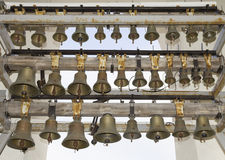 Brass bells in the cathedral Stock Images