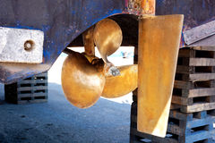 Brass boat propeller and steering. In beached ship Stock Photography