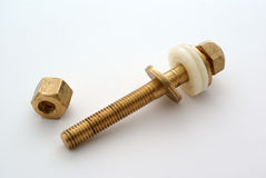 Brass bolt and nut. Shiny brass bolt and nut Stock Images