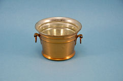 Brass bowl vase on blue background Stock Photo