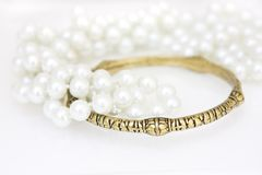 Brass bracelet and imitation pearls Stock Photography