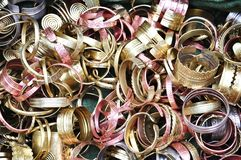 Brass bracelets. In traditional crafts market royalty free stock photos