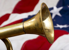 Brass Bugle. Brass bugle on a American flag stock photo