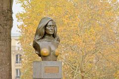 Brass bust of French singer Dalida. Brass bust of teh famous French singer Dalida, found in Montmartre in Paris, selective focus Stock Photo