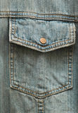Brass button pocket. One brass button on a denim shirt pocket Stock Photo