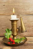 Brass candlestick and burning candle Royalty Free Stock Images