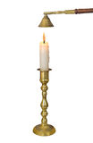 Brass candlestick with candle isolated. Antique single brass candlestick holding a lit candle, with an antique candle snuffer. Isolated on white stock photo