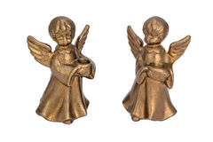 Brass candlesticks in the form of angels holding a candle Royalty Free Stock Image