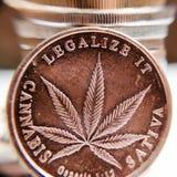 Brass cannabis coin Royalty Free Stock Photos