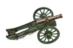 Brass cannon on green painted carriage old vintage isolated on w Stock Photos