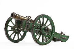 Brass cannon on green painted carriage old vintage isolated on w Stock Photo