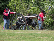 Brass Cannon. Red Bluff, California, United States-April 25, 2015: A Union cannon crew awaits orders to fire during a Civil War reenactment royalty free stock images