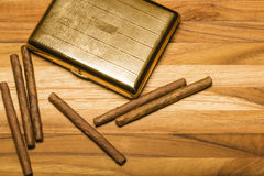 Brass Cigarette Case and Cuban Cigarillos Royalty Free Stock Images