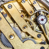 Brass clockwork of old mechanical watch. Watchmaker workshop - brass clockwork of old mechanical watch Royalty Free Stock Image