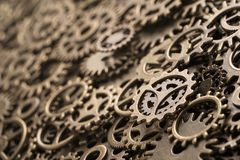 Brass cog wheels, background with copy space Stock Image
