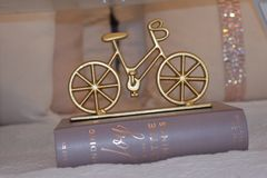 Brass-colored Bike Table Decor Royalty Free Stock Images