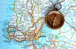 Brass compass in a Lisbon map. Close up of an ancient brass compass on a lisbon map as background Royalty Free Stock Photo