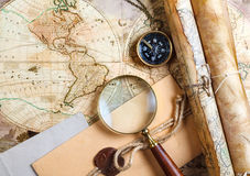 An  brass compass on a old map background Royalty Free Stock Images