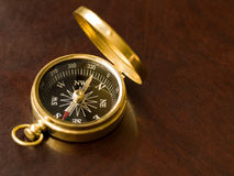 Brass Compass on Wood Royalty Free Stock Photos