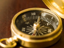 Brass Compass on Wood Stock Image