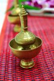 Brass cup for sharing loving kindness Stock Photos