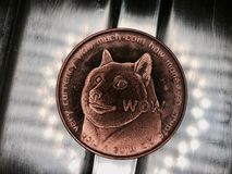 Brass dogecoin coin. Digital currency physical brass dogecoin coin with dog on front stock image