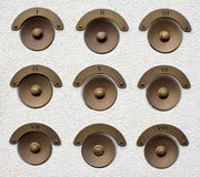 Brass door bells old style Stock Photos
