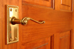 Brass door handle. Brass handle on pine door Royalty Free Stock Photo