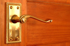 Brass door handle. Brass handle on pine door Stock Photography