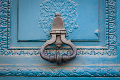 Brass door handle on a colorful blue door Stock Photography