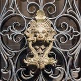Brass door handle on the door lion royalty free stock photos