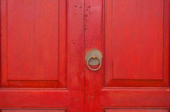 Brass door handle and knocker in chinese style on a red wooden d Royalty Free Stock Photos