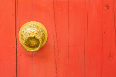 Brass door handle and knocker Royalty Free Stock Photography