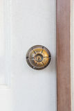 Brass door knob on the Cream door Royalty Free Stock Photo