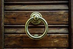 Brass door knocker background. Wooden door with round brass door knocker stock photos
